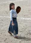 Afghan girl playing baseball in 2002