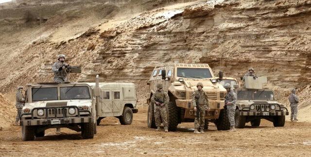 File:9x01 Convoy Soldiers.jpg