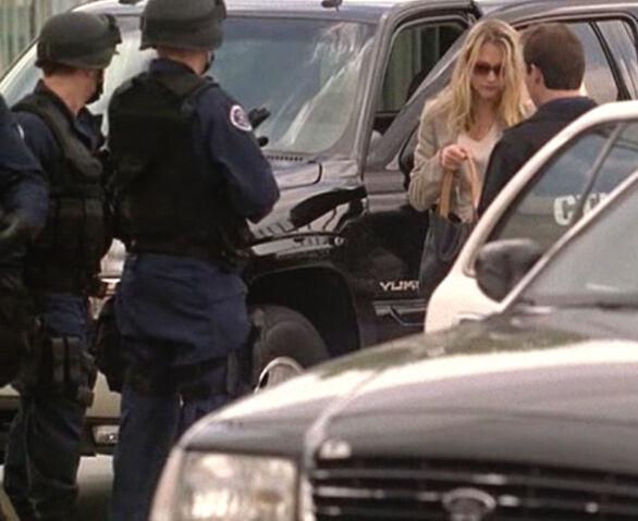 File:2x24 CTU agents checking Kate Warner.jpg