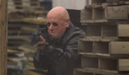 7x24- bald Alan Wilson mercenary