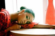 300px-Karen David with black hair and head on the table
