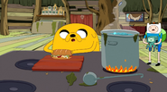 S5e33 Jake completing his sandwich