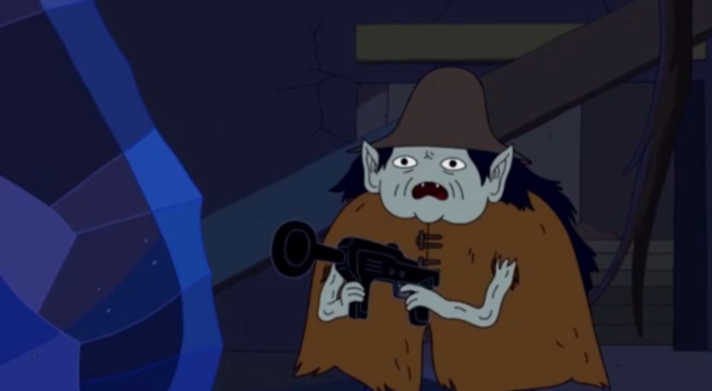 File:S5 e1 1000 year old person with gun.PNG