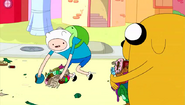 S4e8 Finn picking up candy litter