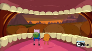 S2e21 finn and jake looking out of giant mouth