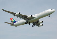 Saa a340-200 zs-sld lands london heathrow arp