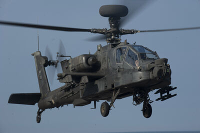 US Navy 120127-N-PB383-090 A U.S. Army AH-64 Apache helicopter approaches the flight deck of the amphibious transport dock ship USS New Orleans (LP