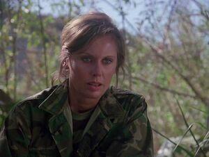 Charmaine in jungle uniform-once a hero