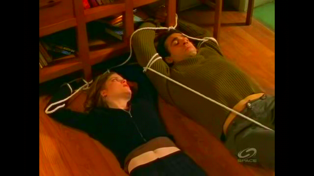 File:Mel and Cole tied up..png