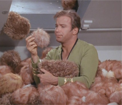 File:Kirk surrounded by Tribbles.jpg
