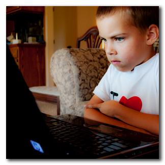 File:Karate kid - TK watching movie on laptop.jpg