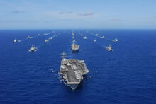 US Navy 100724-N-5684M-823 USS Ronald Reagan (CVN 76) transits the Pacific Ocean with ships assigned to Rim of the Pacific (RIMPAC) 2010 combined task force as part of a photo exercise north of Hawaii