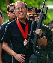 Aquino iii with a gun