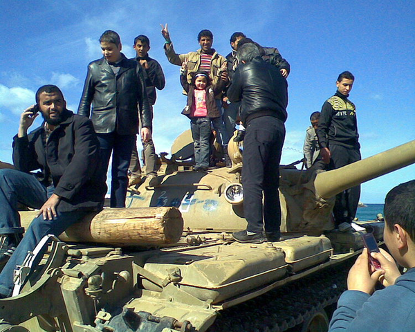 File:People on a captured tank.PNG