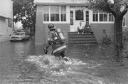 Gloria-1985-a-firefighter-helps-with-flooding-in-freeport