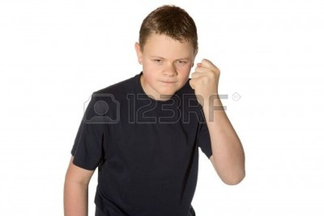 File:14129266-angry-casual-young-man-in-a-black-t-shirt-with-glaring-eyes-shaking-his-fist-at-the-camera-isolated-.jpg