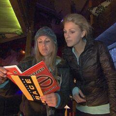 Caroline & Jennifer reading the Roadblock clue for the Leg 9.