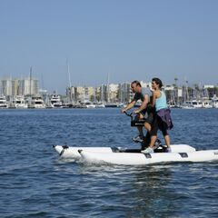 Logan &amp; Chris riding waterbikes in the <a href=