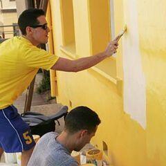 Dan & Jordan painting a house.