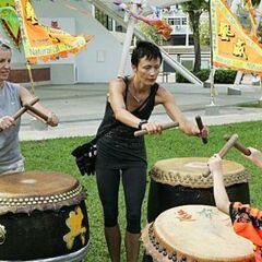 Carol &amp; Brandy doing the <i>Pounding Drums</i> Detour in Leg 9.
