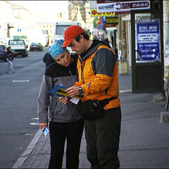 Chad & Stephanie reading a clue during the seventh leg.
