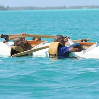 The twins' outrigger canoe has capsized.