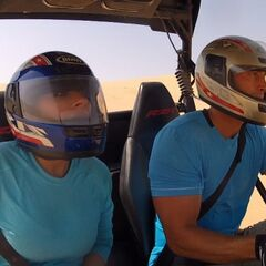 Jason &amp; Amy driving a dune buggy in <a href=