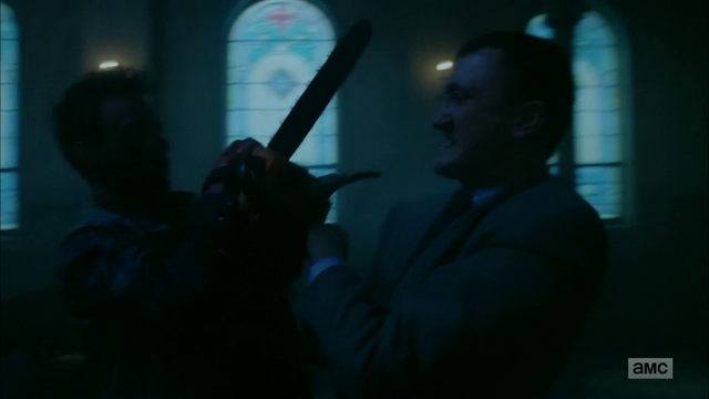 File:Cassidy and Fiore fight over the chainsaw.png