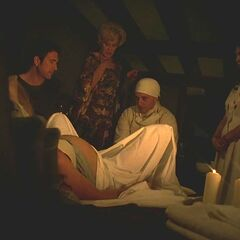 Dr Montgomery, Gladys and Maria assist Vivien's birth.