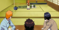 Ichigo and his friends watch Orihime tend to Nozomi's injuries