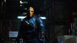 Deathstroke attacks Caitlin and Cisco.png