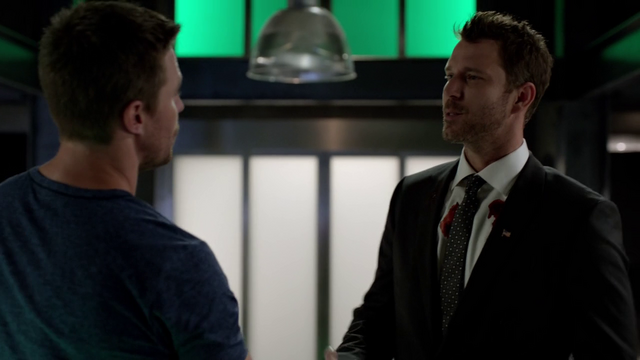 File:Christopher Chance introduces himself to Oliver Queen after faking the latter's death.png