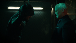 Damien Darhk about to unmask the Green Arrow