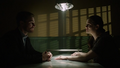 Oliver talks to a handcuffed Helena.png