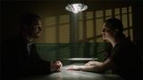 Oliver talks to a handcuffed Helena