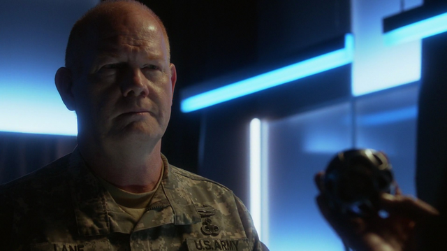 File:General Lane gives the Omegahedron to Maxwell Lord.png