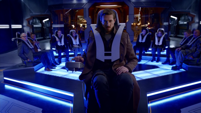 File:Rip Hunter pilots the Waverider for his team for the first time.png