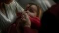 Baby Kal-El being held by his parents.png