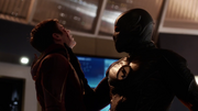 Zoom holds Barry by the throat