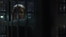 Oliver imprisoned on the Amazo