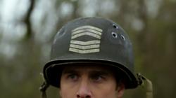 Sgt. Rock's helmet on his head