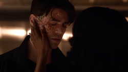 Iris touches Savitar's face