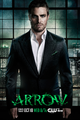 Arrow promo - Oliver in a suit above Starling City.png