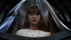 Kara in her pod preparing to be rocketed away from Krypton