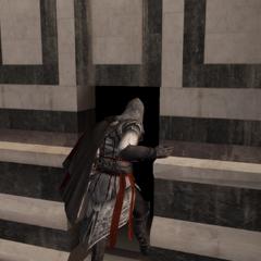 Ezio gaat het gebouw binnen.