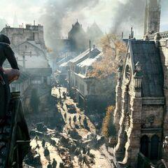 Arno in een gehurkte houding op een dak.