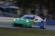 2014-Sebring-No17-Team-Falken-Tire-Porsche-911-RSR-At-Speed 001