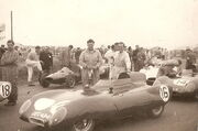 J Crosthwaite (with oily rag) and Graham Hill (on left of picture) with Lotus