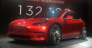 Candy Red Tesla Model 3 trimmed 2