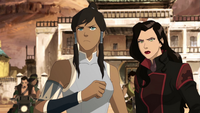 Korra and Asami facing bandits